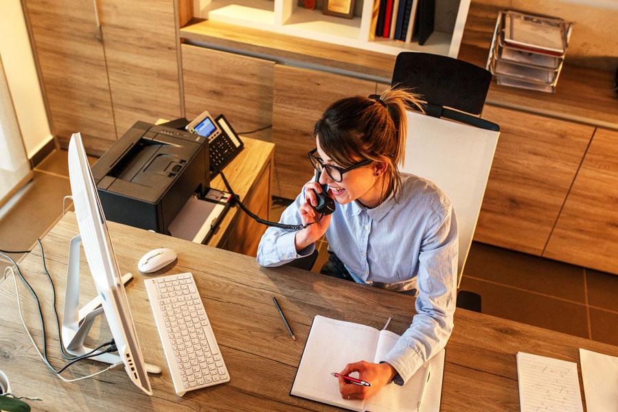 Header - Business Insurance Woman at Her Desk